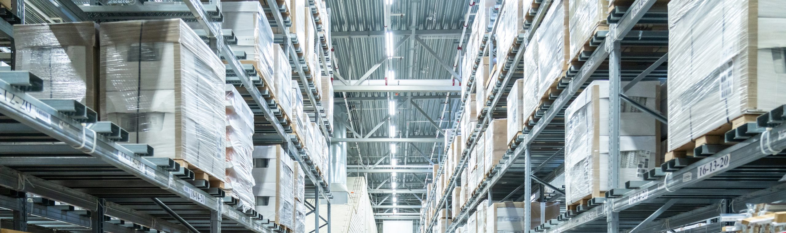 Shelves with boxes in modern warehouse